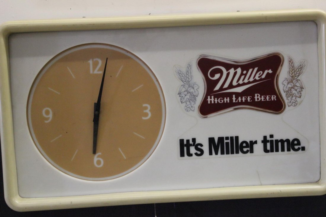 20: MILLER ADVERTISING CLOCK LIGHTS UP WORKS FINE