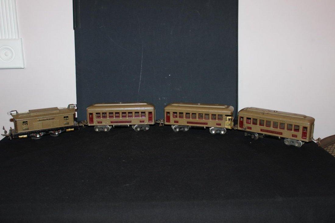 4 PIECE LIONEL METAL TRAIN SET WITH TRACK TRANSFORMER