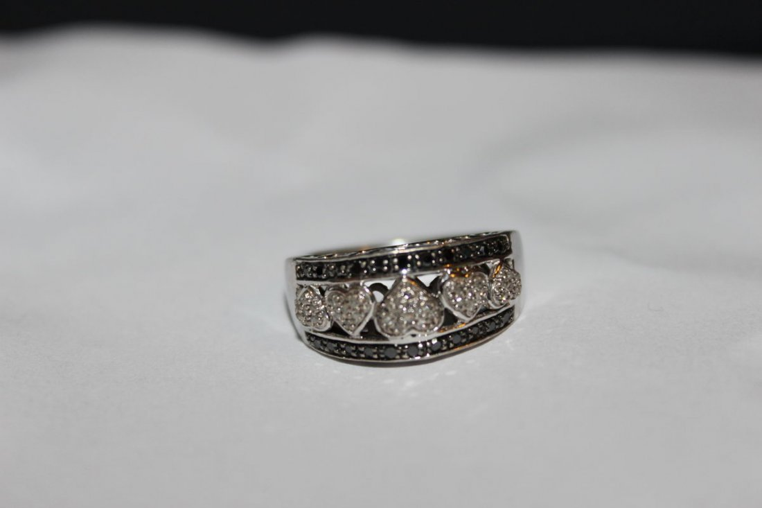 STERLING SILVER WITH GENUINE WHITE AND BLACK DIAMONDS