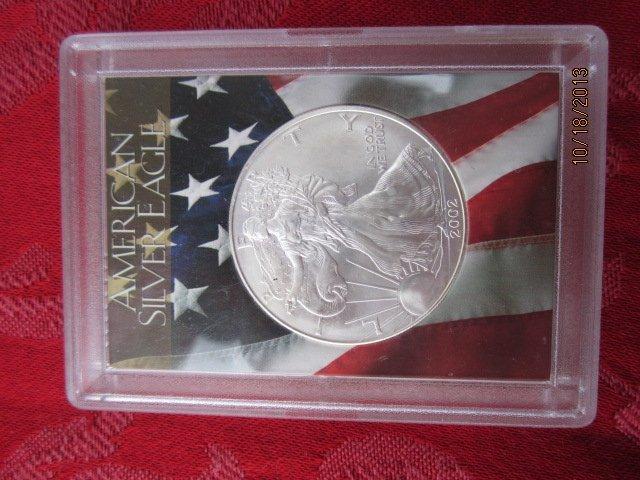2002 AMERICAN 1 OUNCE SILVER EAGLE H.E. HARRIS AND