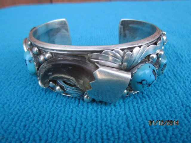 OUTSTANDING NAVAJO FAUX BEAR CLAW AND TURQUOISE