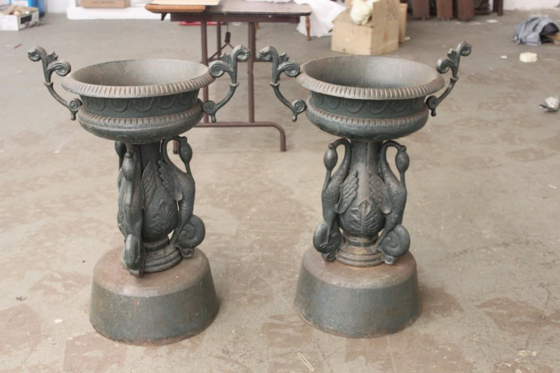 MATCHING PAIR OF CAST IRON URNS IN EXCELLENT CONDITION