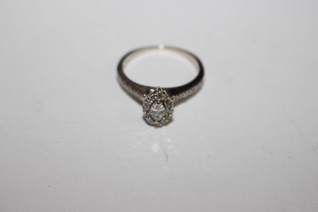 14 K DIAMOND RING FEATURES SOLITAIRE MARQUIS CUT CENTER