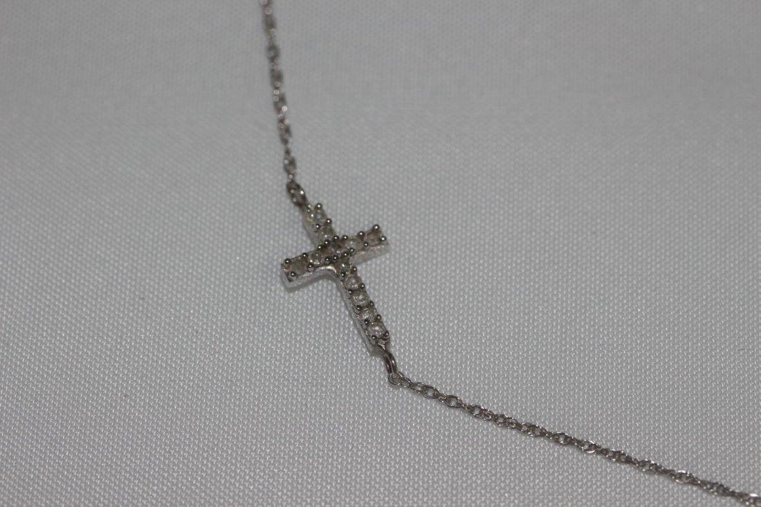 10K DIAMOND CROSS NECKLACE FEATURES 12 GENUINE DIAMONDS