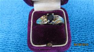 K ORNATE GOLD RING WITH A BLUE SAPPHIRE