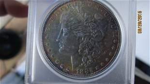 1885 US SILVER DOLLAR AU. CONDITION GOOD BREAST