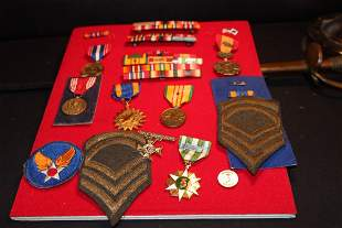 LARGE COLLECTION OF MILITARY BRONZE METALS, BADGES,