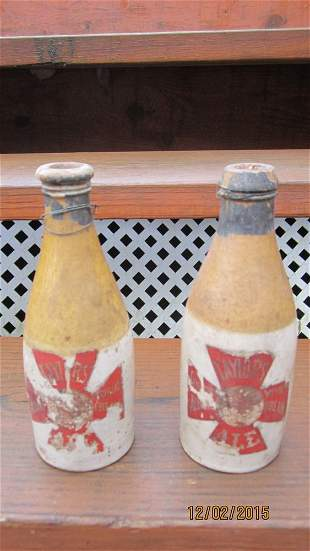 2 EARLY CIR. 1860'S STONEWARE BOTTLES - POSSIBLY FOR