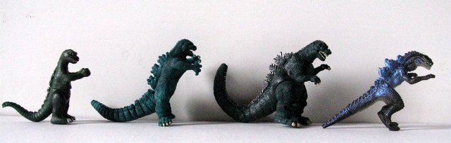 "GODZILLA TOY FIGURE LOT OF FOUR - Left to right: 4"" - 2"