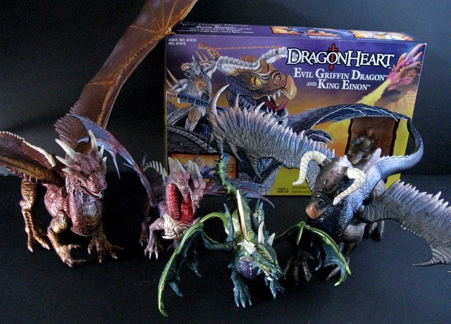 DRAGONHEART - LOT OF FOUR DRAGON FIGURES PLUS ONE BOX -