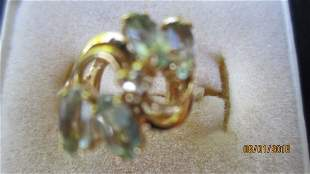 10K YELLOW GOLD RING W/ 4 MARQUISE CUT AQUAMARINES AND