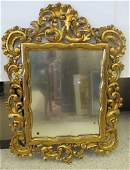 Ornately Carved Antique Gilt Wood Rococo Mirror