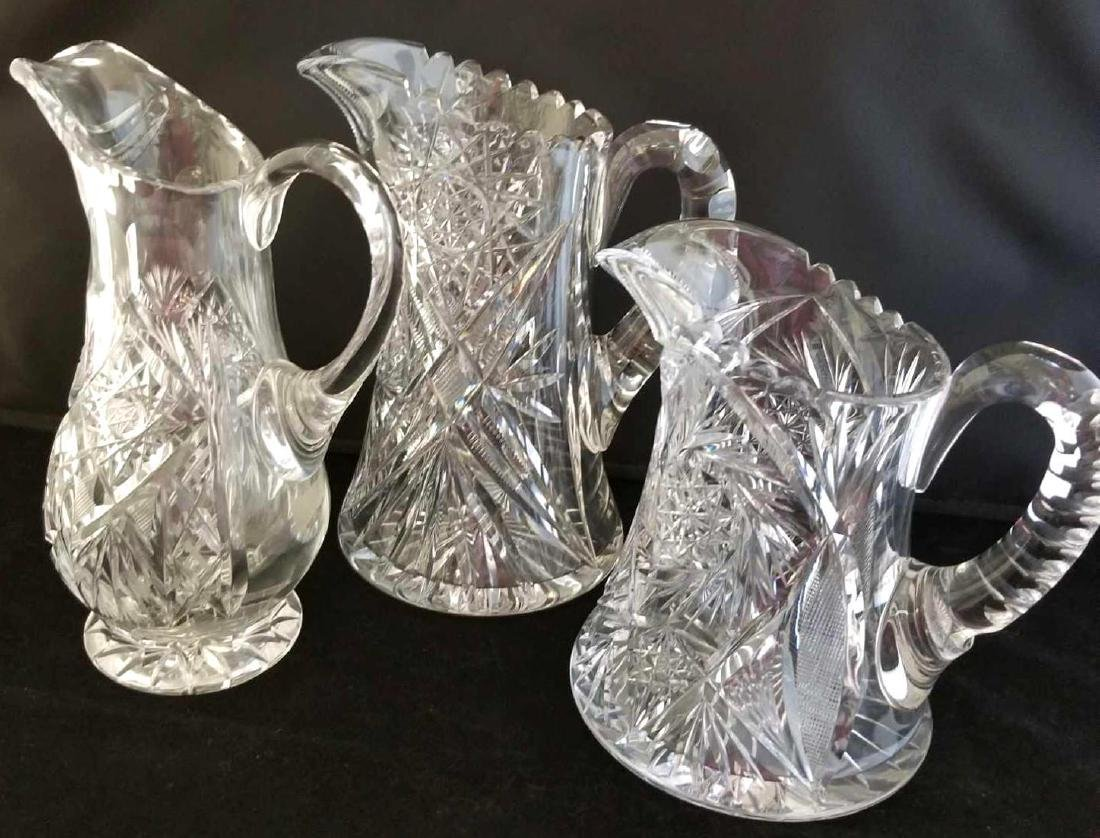 Trio of Cut Crystal Pitchers