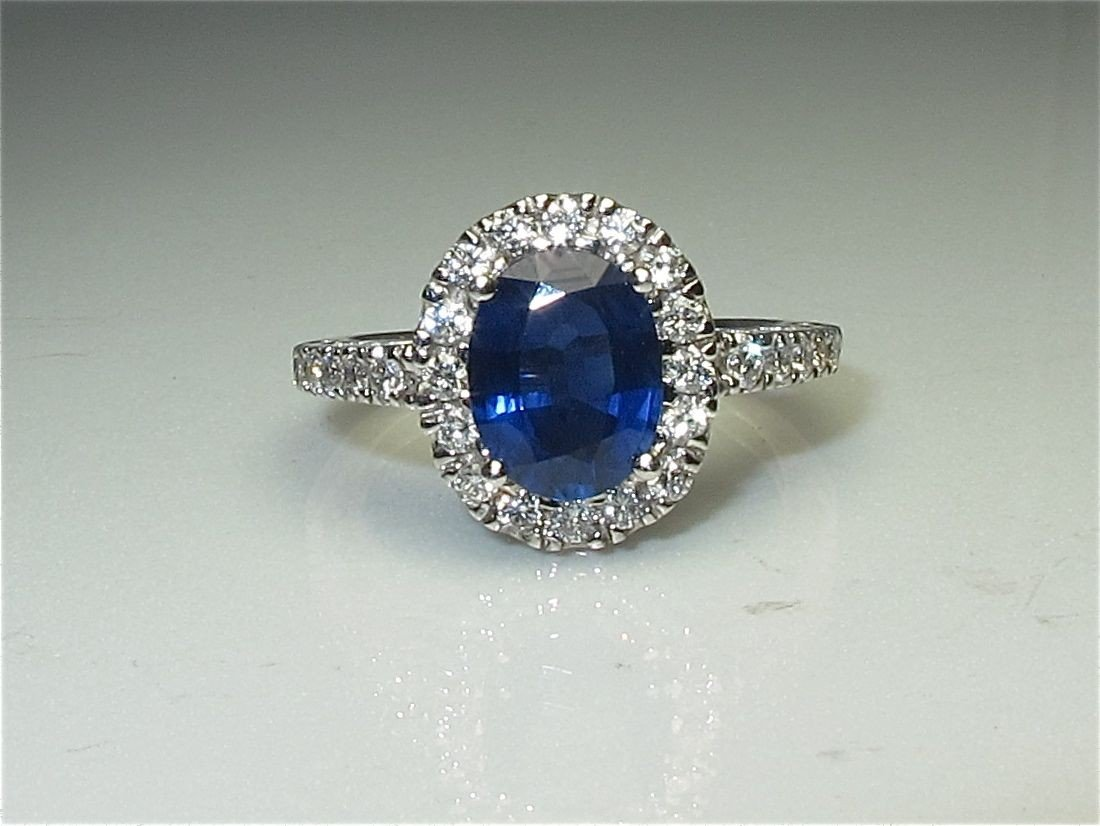 59: 18K White Gold Sapphire and Diamond Ring, Containin