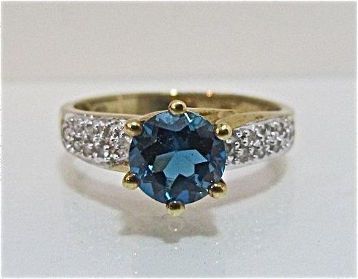 83: 10K Yellow Gold Blue Topaz & Diamond Ring, 1.78dwt