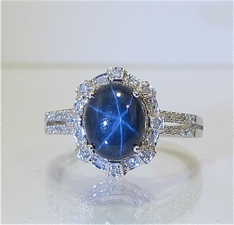 101: 14K White Gold Star Sapphire & Diamond Ring