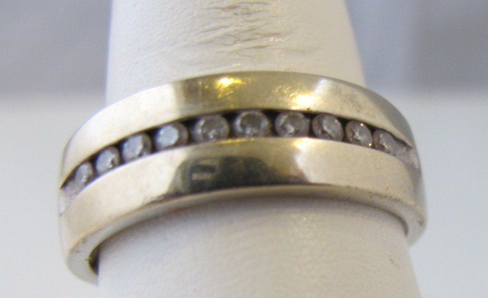 102: 14K White Gold Diamond Band Containing 10 Diamonds