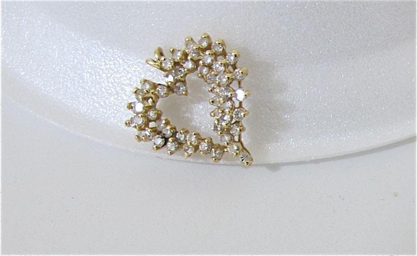 20: 14K Yellow Gold Diamond Heart Pendant