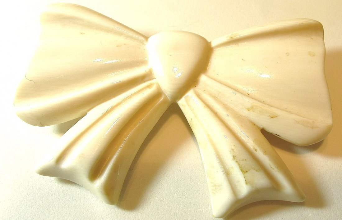 14: Carved Ivory Bow Pin