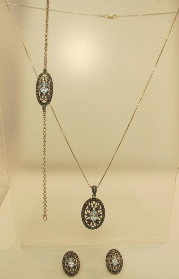 14: Sterling Silver and Blue Topaz Necklace, Bracelet &