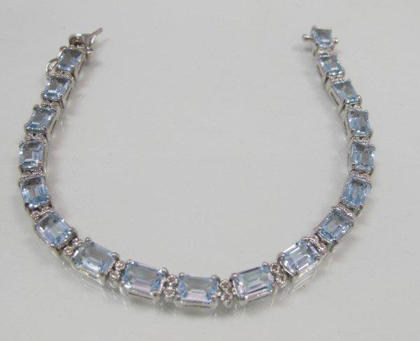 Sterling Silver Sky Blue Topaz and Diamond Bracelet,