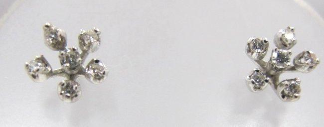 14K White Gold Diamond Earrings Containing 12 Brilliant