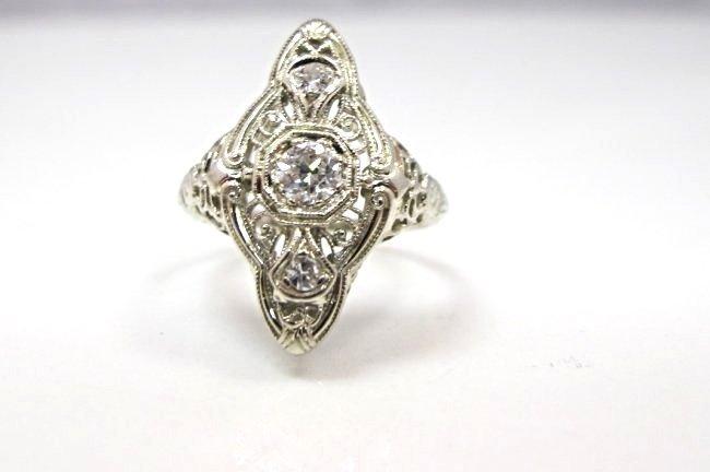 18K White Gold Diamond Ring Containing 1 Center