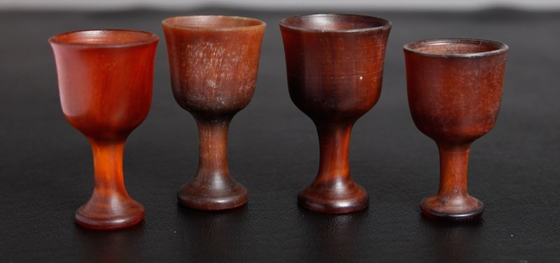 46: 4 CHINESE CARVED HORN WINE GOBLETS