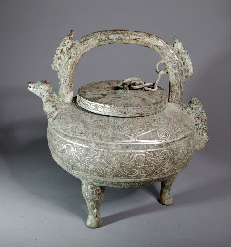 17: CHINESE BRONZE TRI FOOTED JAR WITH LID