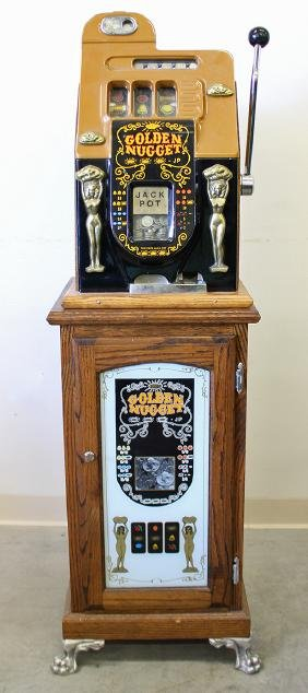 25 CENT MILLS GOLDEN NUGGET SLOT MACHINE WITH BASE