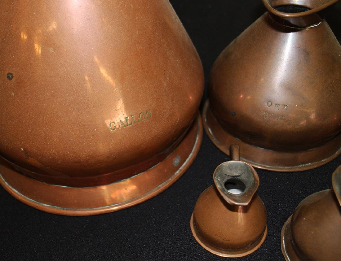 ENGLISH GRADUATED COPPER PITCHERS - 10