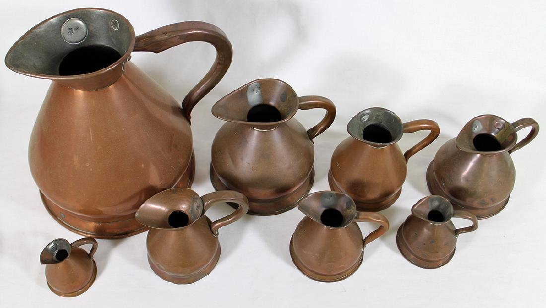 ENGLISH GRADUATED COPPER PITCHERS - 2