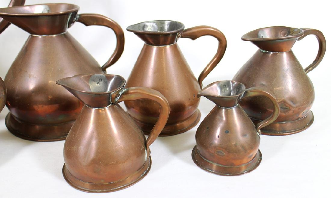 ENGLISH GRADUATED COPPER PITCHERS - 3