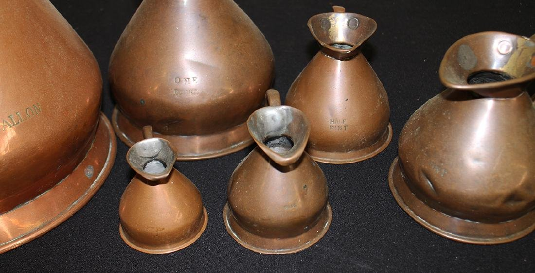 ENGLISH GRADUATED COPPER PITCHERS - 9