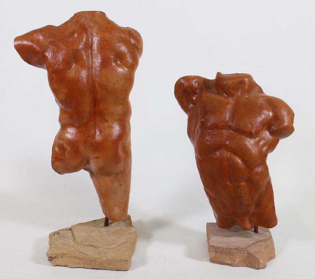 PAIR OF NUDE TORSO SCULPTURES