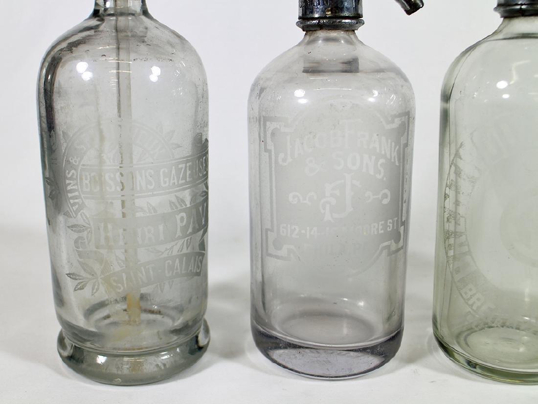 (4) ANTIQUE CLEAR GLASS SELTZER BOTTLES - 4