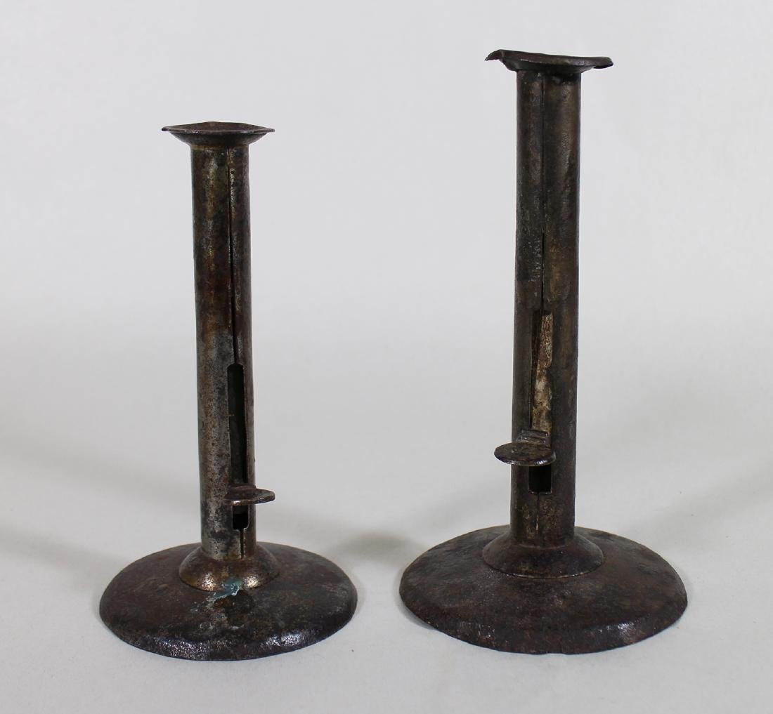 18th/19th C IRON HOGSCRAPER PUSH UP CANDLESTICKS