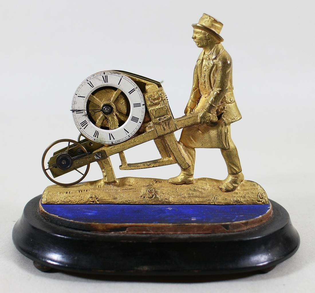 19TH CENTURY GILT WHEELBARROW CLOCK