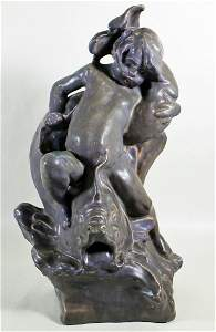ROOKWOOD POTTERY BOY & DOLPHIN SCULPTURE