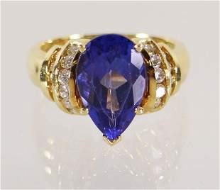 18K GOLD 4.79 CARAT TANZANITE & DIAMOND RING