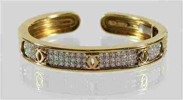 VINTAGE 18K CARTIER DIAMOND BANGLE BRACELET