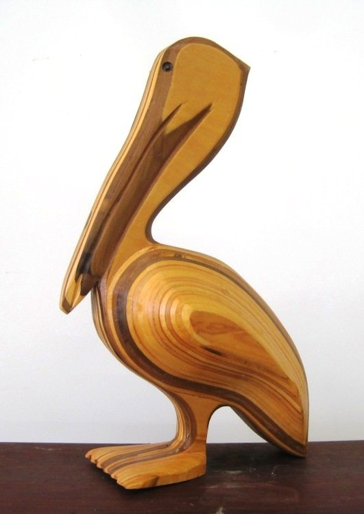 CARVED MULTI LAYERED WOOD PELICAN