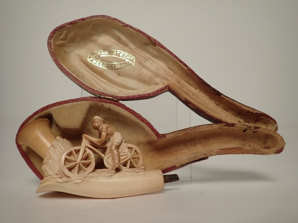Meerschaum Pipe with Carved Man on Bicycle Design