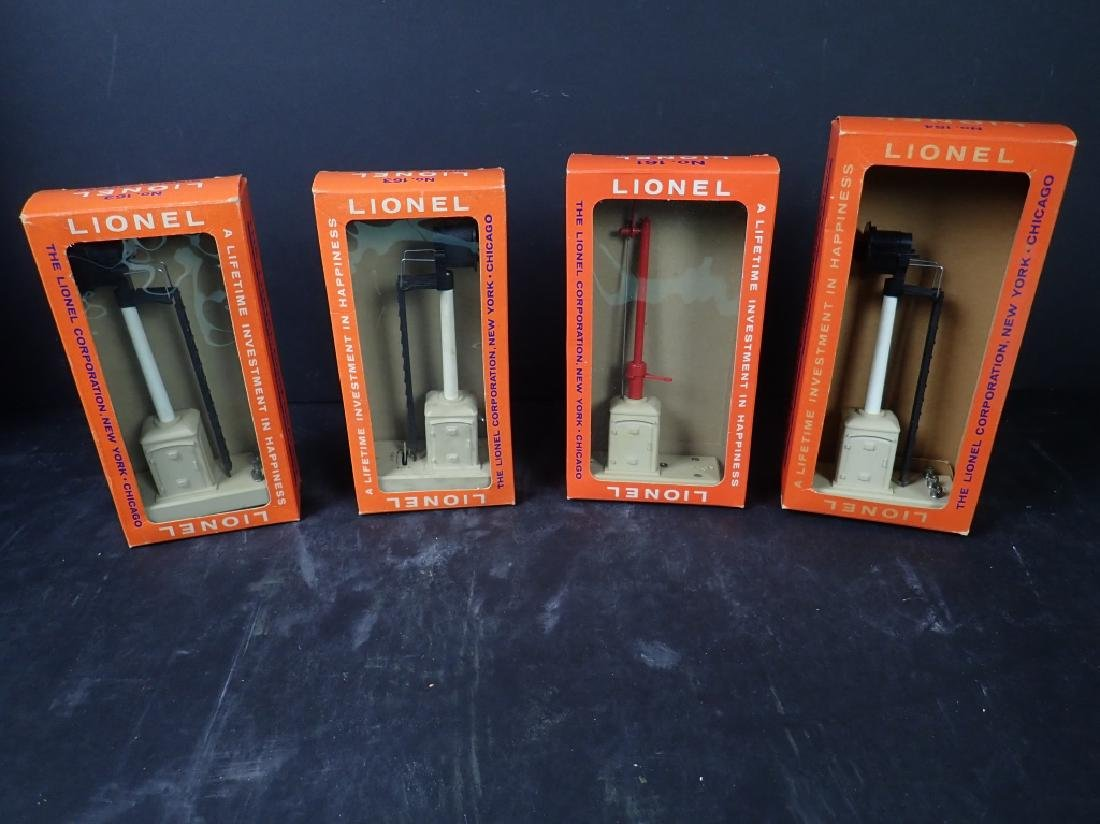 Four Vintage Boxed Lionel Train Signals
