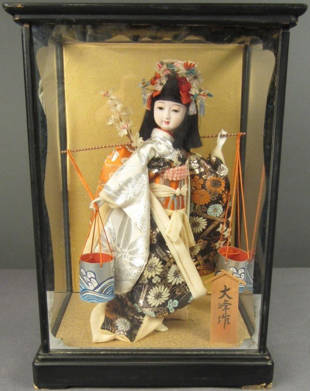 88: Japanese doll in wood and glass case