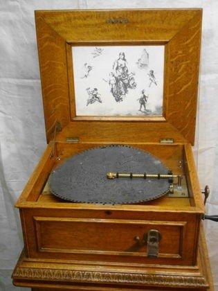 1050: Regina Music Box, restored oak case, double comb,