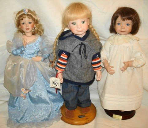 8: 3 pc porcelain dolls