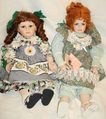 10: 2 pc porcelain dolls