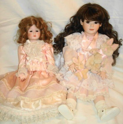 11: 2 pc Porcelain dolls