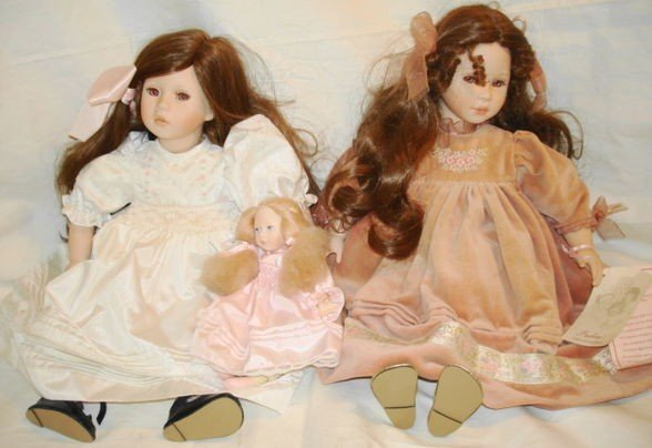 13: 2 pc. Porcelain dolls